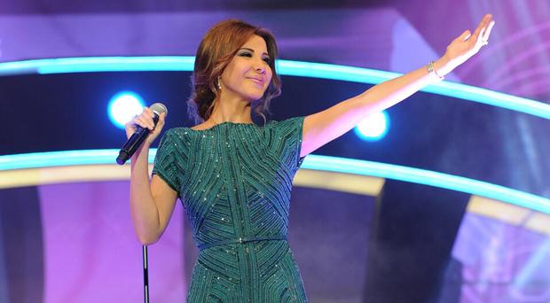 بالصور: نانسي عجرم أحيت أجمل وأضخم حفلات ليالي دبي وأشعت جمالاً بالأخضر